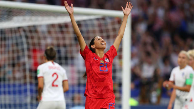 christen-press-arms-celebration-mom-uswnt.jpg