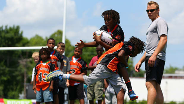 Using Rugby to Learn to Tackle Safely in Football