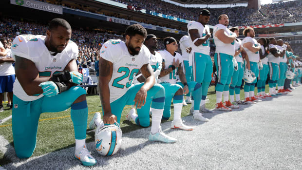 arian-foster-dolphins-national-anthem-kneel.jpg