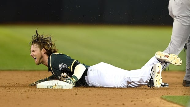josh-reddick-athletics-broken-thumb.jpg