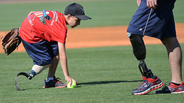 Young Amputees Team Up with Wounded Warriors at Softball Camp