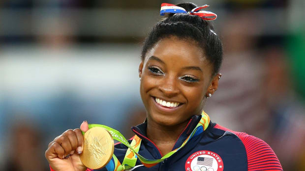simone-biles-closing-ceremony-flag-bearer.jpg