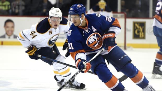 Islanders Star Kyle Okposo Helps Launch New Toy Rinks
