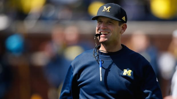 jim-harbaugh-nick-saban-satellite-camps-twitter.jpg