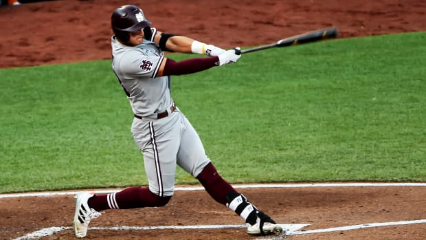 Jun 20, 2021; Omaha, Nebraska, USA; Mississippi State Bulldogs outfielder Brad Cumbest (33) drives in a run with a triple against the Texas Longhorns in the fourth inning at TD Ameritrade Park.