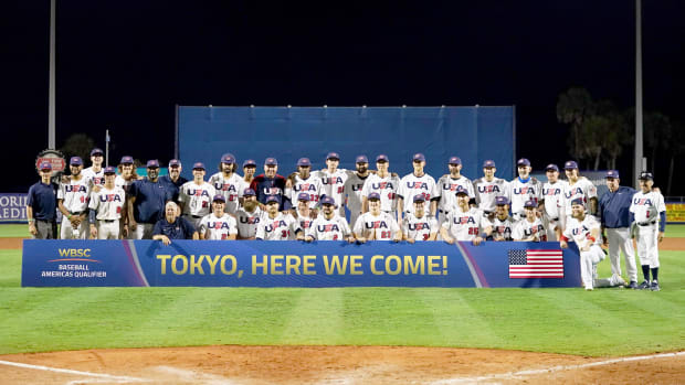 Jun 5, 2021; Port St. Lucie, Florida, USA; USA players pose for a picture after defeating Venezuela in the Super Round of the WBSC Baseball Americas Qualifier series game at Clover Park, and qualifying for the Olympic Games in Tokyo Japan.