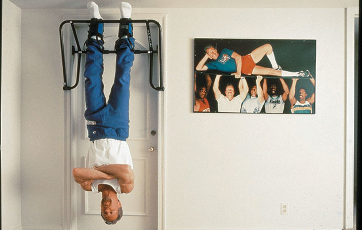 Croce hung upside down from an exercise bar next to a photo of Philadelphia sports legends for a photo within SI's 1996 story.