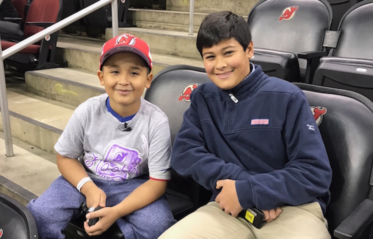 Devils coach for the day Abdiel Collazo with Kid Reporter Christopher John