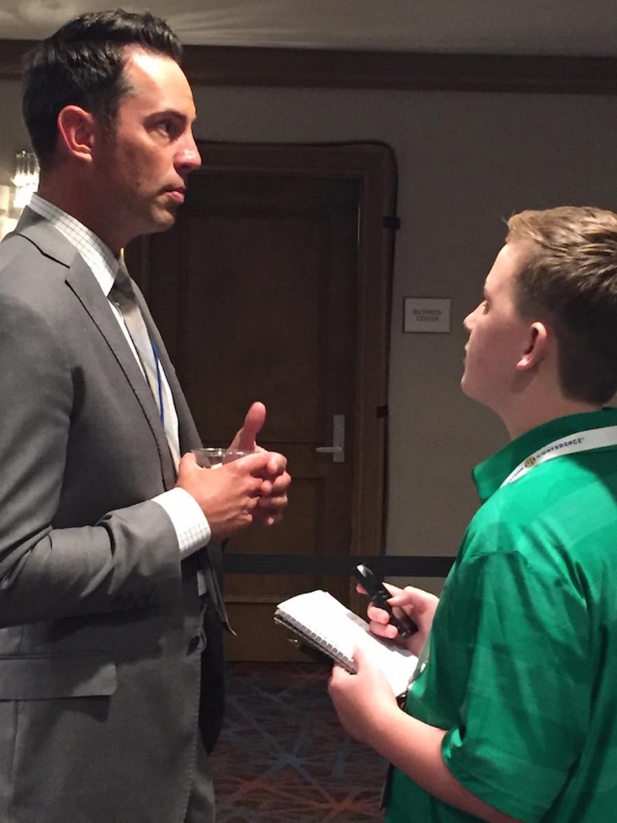 Kid Reporter Jack Ronilo with broadcaster Joe Tessitore