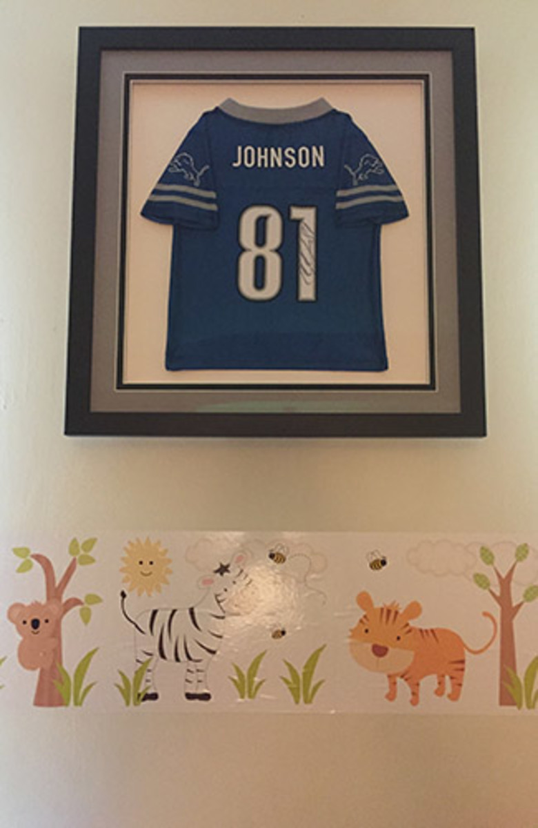 The autographed Calvin Johnson jersey now hangs in Alberta's sons' room.