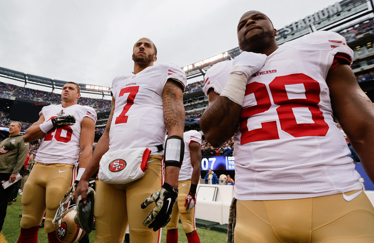 As this November 2014 file photo shows, Kaepernick stood for anthems in previous seasons before deciding to make a statement in 2016.