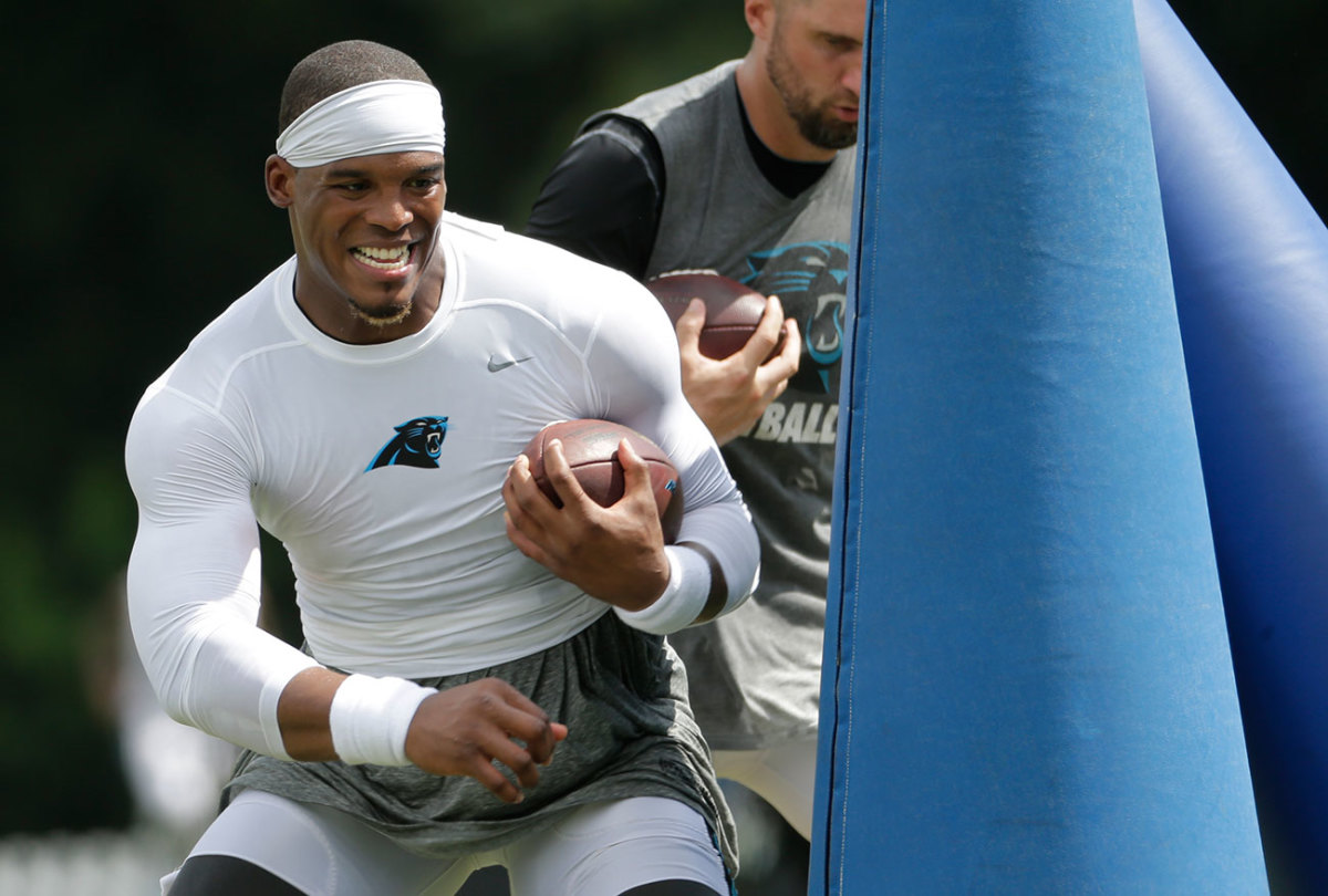 Newton says he's working more this year on finding his outlets, rather than scrambling or taking the sack.