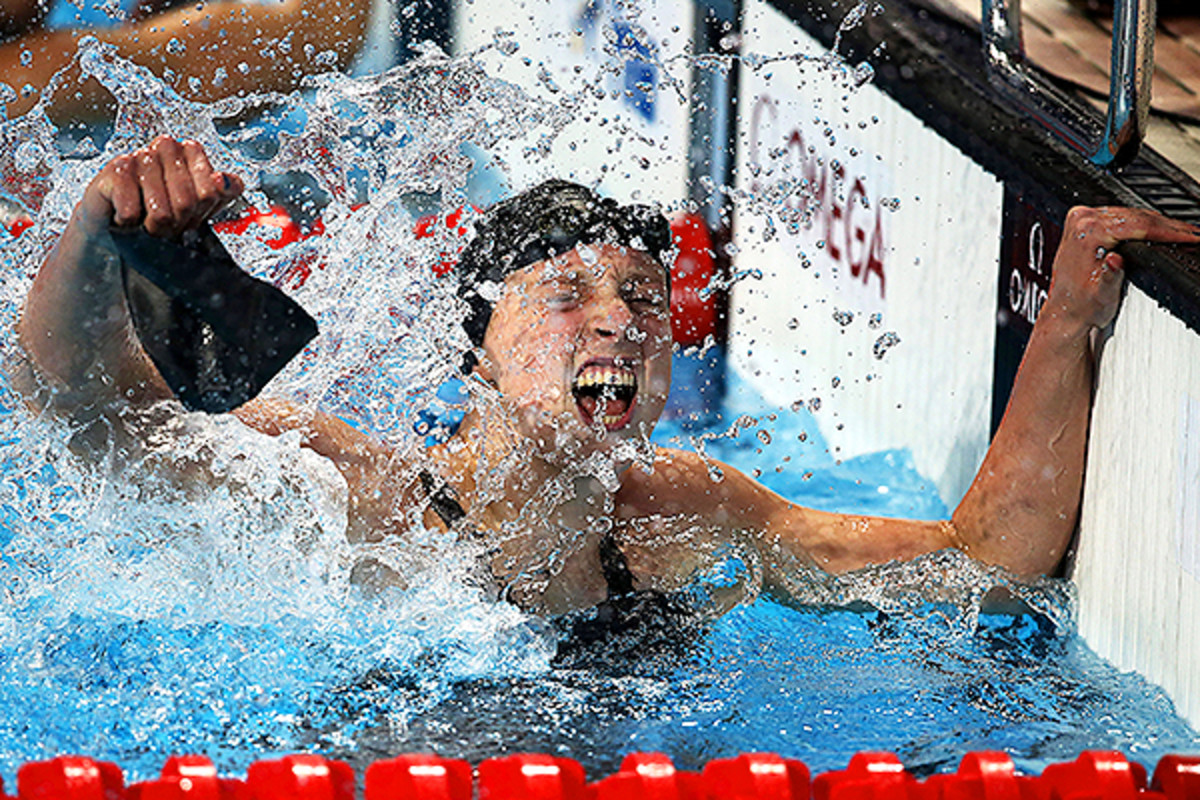 Katie Ledecky celebrates after winning the 800 at the 2015 FINA World Championships/
