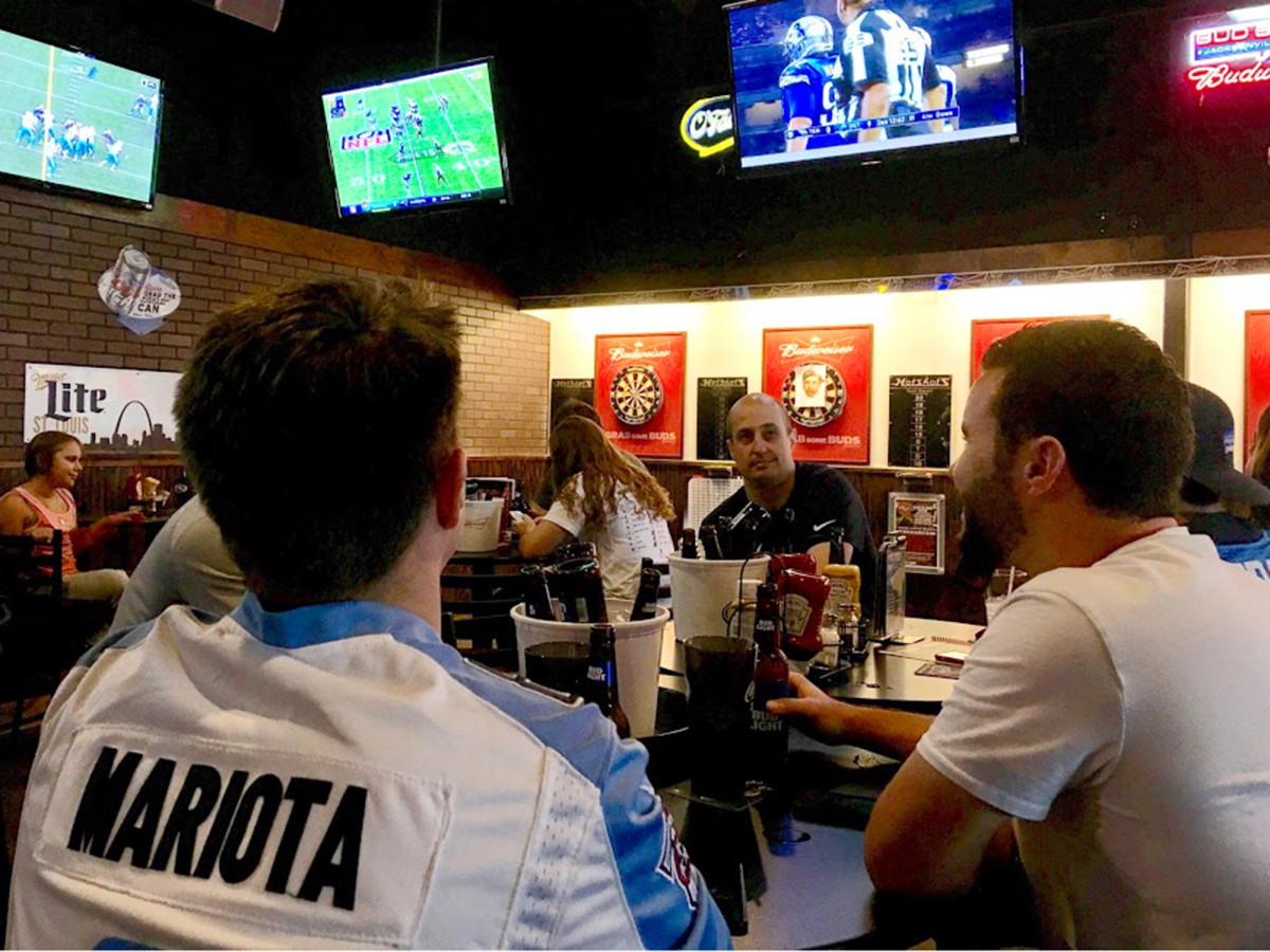 Once a Rams fan, Mike Hamon (left, in jersey) now watches Marcus Mariota and the Titans at Hotshots in St. Louis.