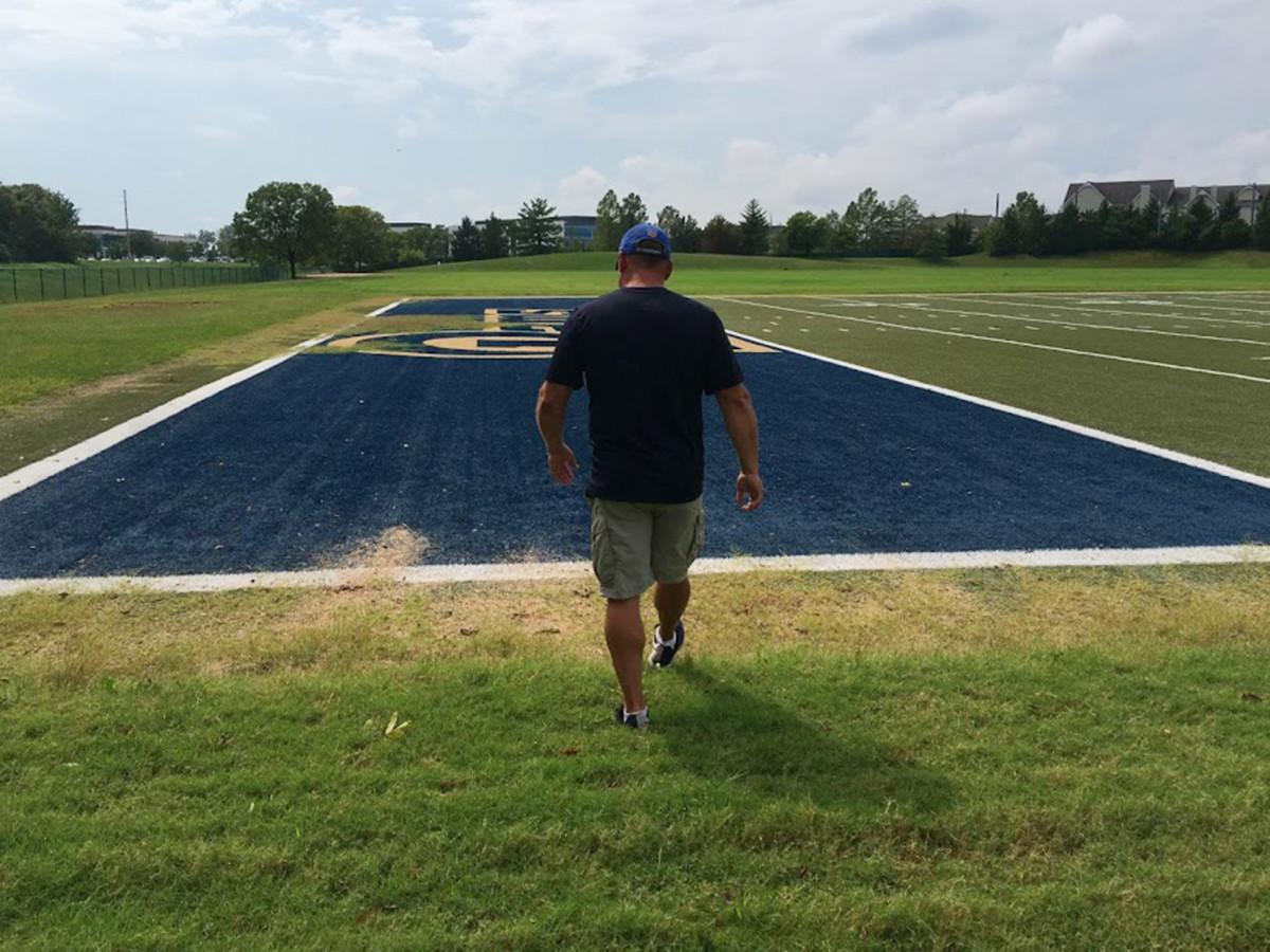 Matt Litzsinger on the dead patches of grass at Rams park.