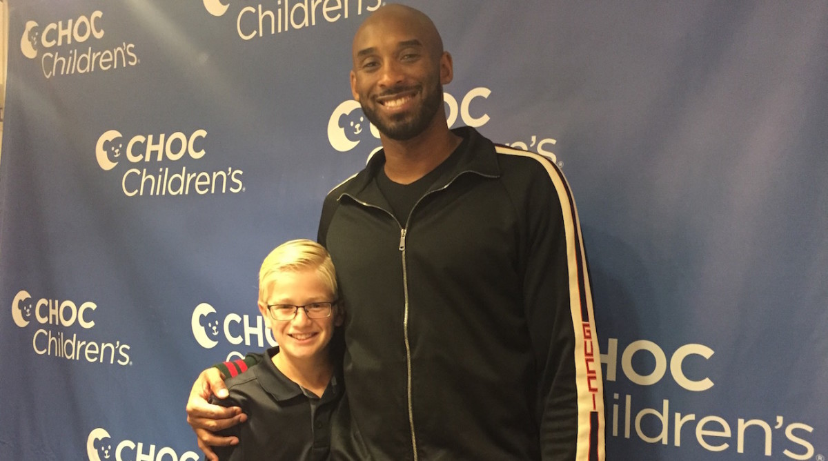 Kid Reporter Carlo Vellandi and Kobe Bryant.