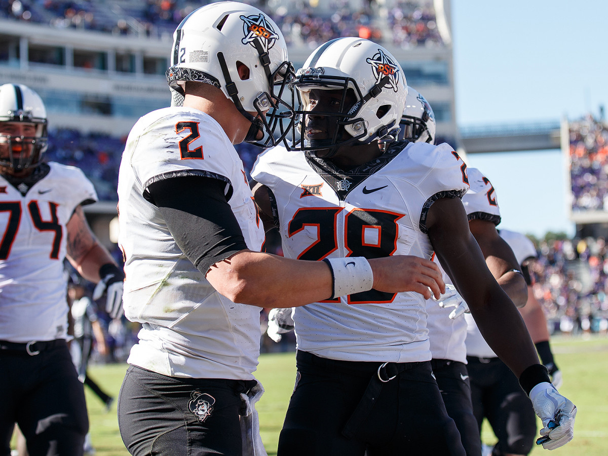 Mason Rudolph and James Washington could both end up in the first round of next year's NFL draft—but they have work to do in Stillwater.