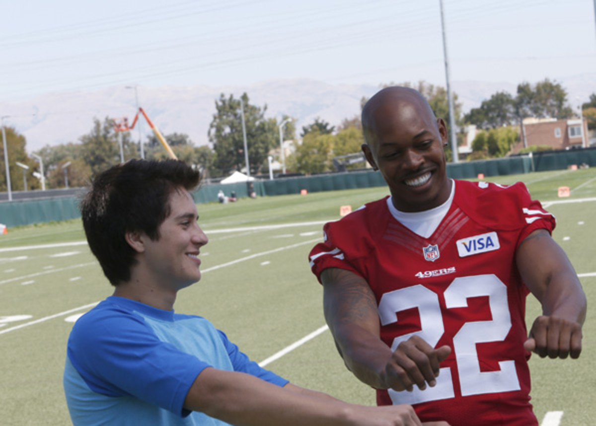 billy unger with carlos rogers of the 49ers