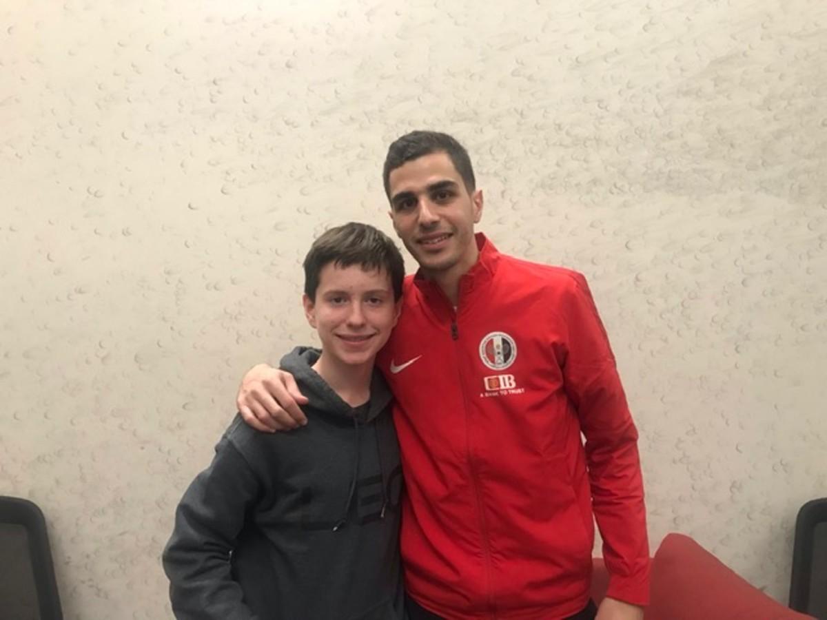 SI Kids reporter Ian Springer with Egypt's Ali Farag, the World No. 1 player.