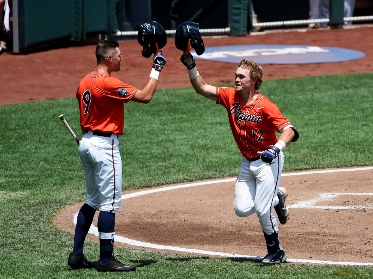 Jun 20, 2021; Omaha, Nebraska, USA; Virginia Cavaliers catcher Logan Michaels (12) celebrates with outfielder Chris Newell (9) after hitting a home run in the third inning against the Tennessee Volunteers at TD Ameritrade Park.