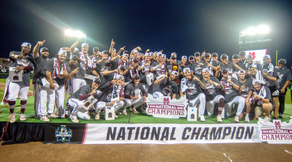 Jun 30, 2021; Omaha, Nebraska, USA;  The Mississippi St. Bulldogs pose for a team photo after winning the national championship against the Vanderbilt Commodores at TD Ameritrade Park.